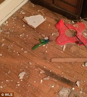 2487C52E00000578-2903018-Damage_was_also_left_on_the_floor_of_his_apartment-m-6_1420788353940
