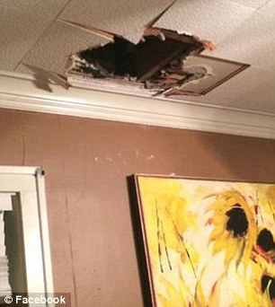 2487CBD100000578-2903018-A_giant_hole_was_seen_in_Connors_ceiling-a-7_1420788362898